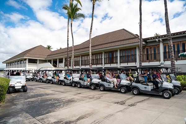 lineup of golf carts